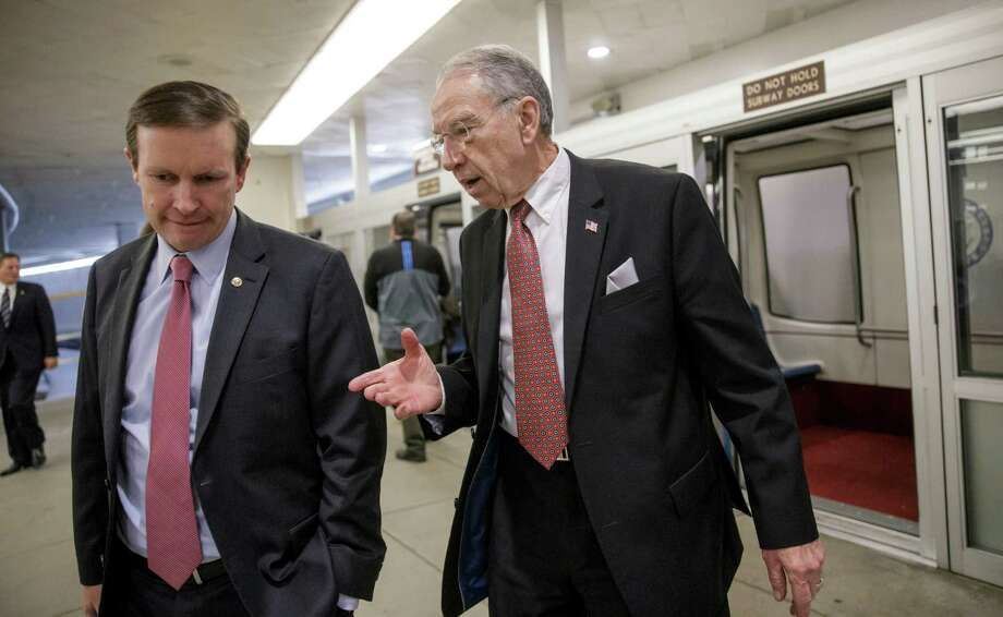 Senate Judiciary Committee Chairman Chuck Grassley, R-Iowa, right, talks to Sen. Chris Murphy, D-Conn., as they walk to the Senate floor Monday. Photo: J. Scott Applewhite, STF / AP