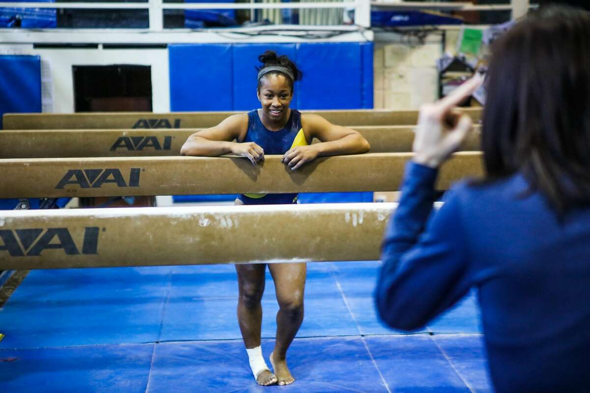 Cal gymnast Toni-Ann Williams talks to coach Elisabeth Crandall-Howell (right) during practice at UC Berkeley, in Berkeley, California, on Thursday, April 7, 2016.