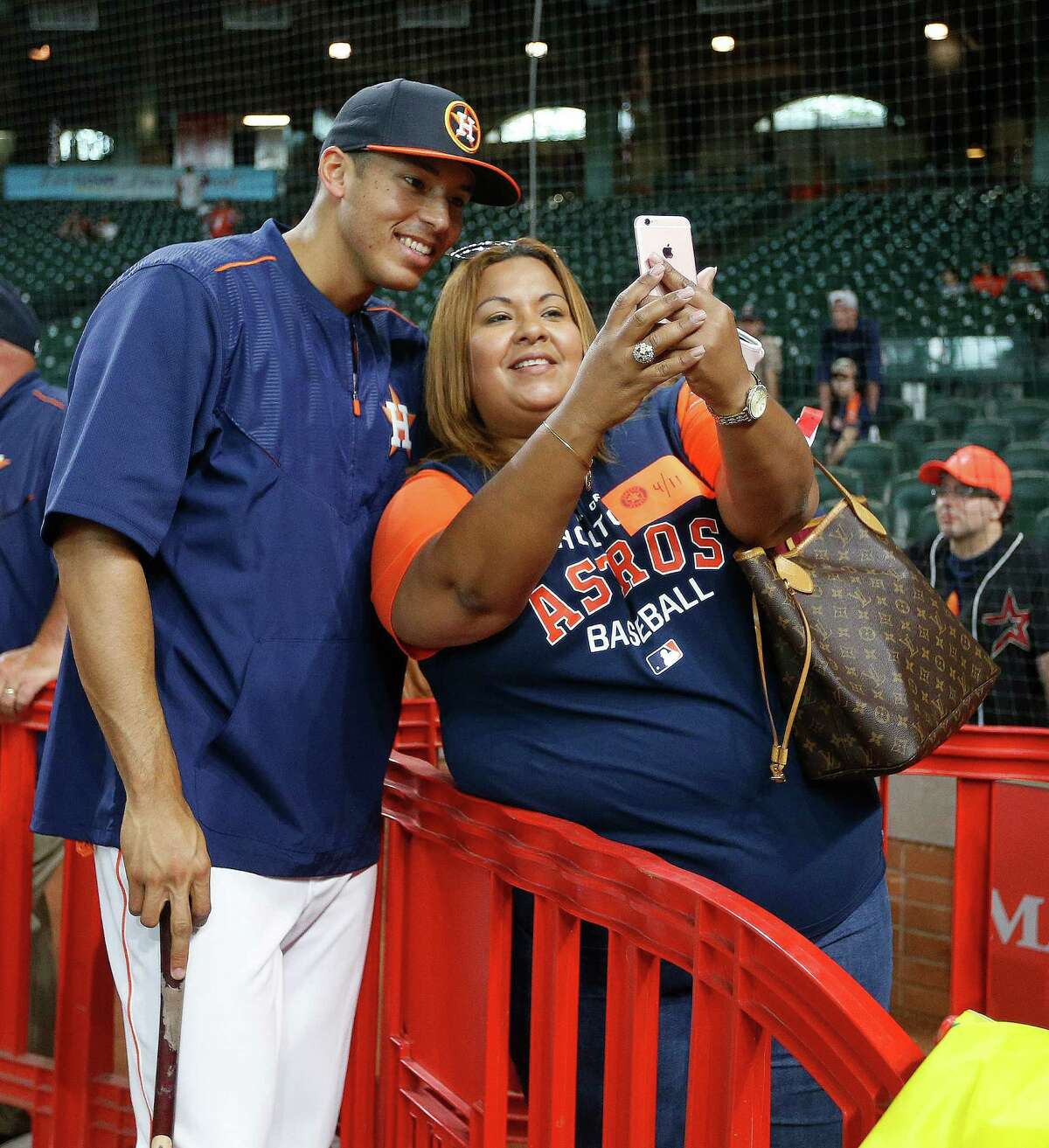 Houston Astros shortstop Carlos Correa takes a photo with his mother Sandybel during batting practice before the start of an MLB game at Minute Maid Park, Monday, April 11, 2016, in Houston.