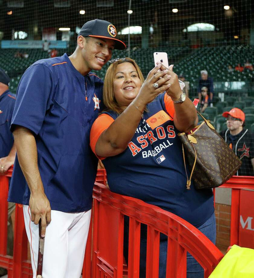 Houston Astros shortstop Carlos Correa takes a photo with his mother Sandybel during batting practice before the start of an MLB game at Minute Maid Park, Monday, April 11, 2016, in Houston. Photo: Karen Warren, Houston Chronicle / © 2016 Houston Chronicle