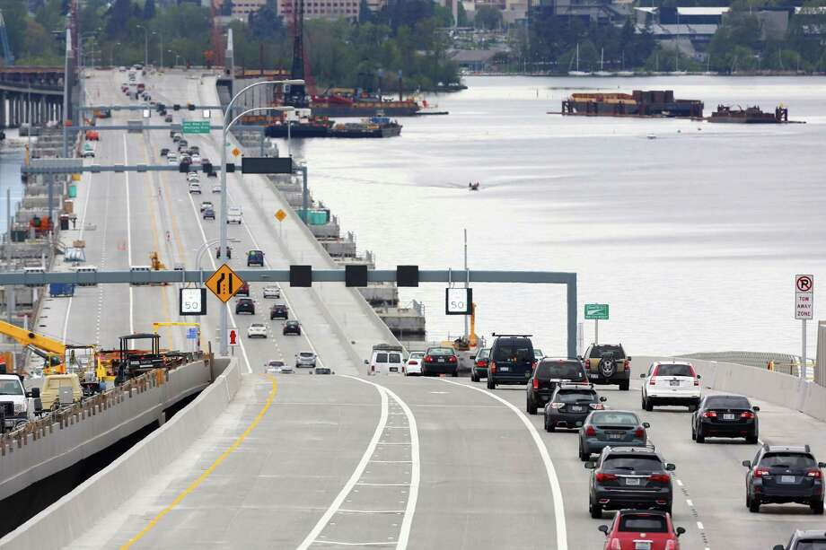A handcuffed man jumped off the state Route 520 bridge early Friday morning during a DUI investigation. Authorities blocked the right lane Friday morning to investigate the scene. Photo: GENNA MARTIN, SEATTLEPI.COM / SEATTLEPI.COM