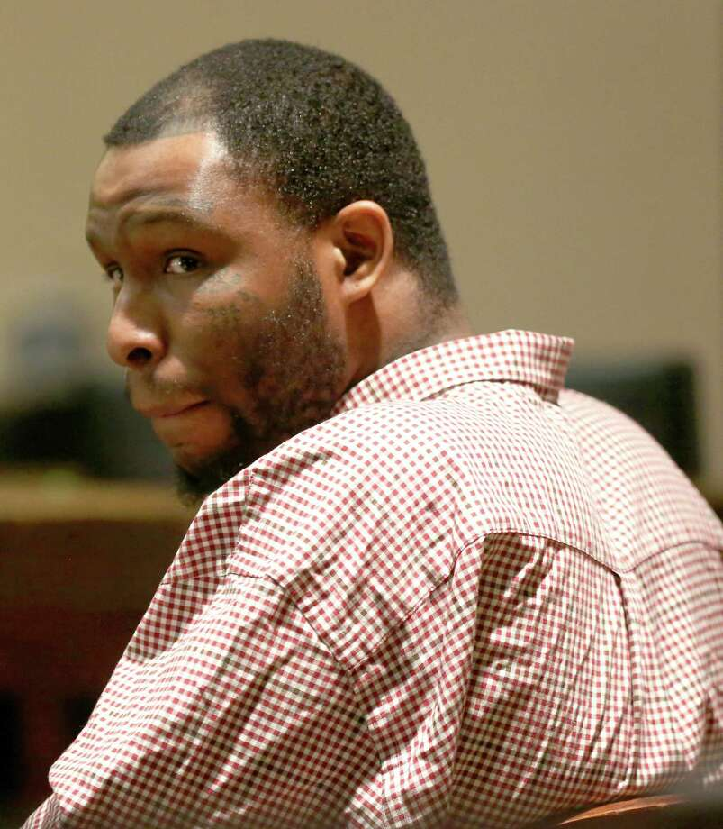 Clarence William ÒHardcoreÓ Wright looks around the courtroom Tuesday, April 5 2016 on the first day of his murder trial in the 186th District Court. Wright is accused of killing Jeremiah Gomez, 35 on Oct. 19, 2013. Photo: William Luther, Staff / San Antonio Express-News / © 2016 San Antonio Express-News