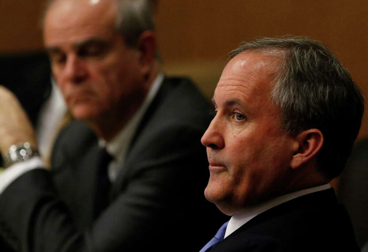 Texas Attorney General Ken Paxton, right, looks at one of special prosecutors during a pre-trial motion hearing at the Collin County courthouse on Tuesday, Dec. 1, 2015, in McKinney, Texas. (Jae S. Lee/The Dallas Morning News)