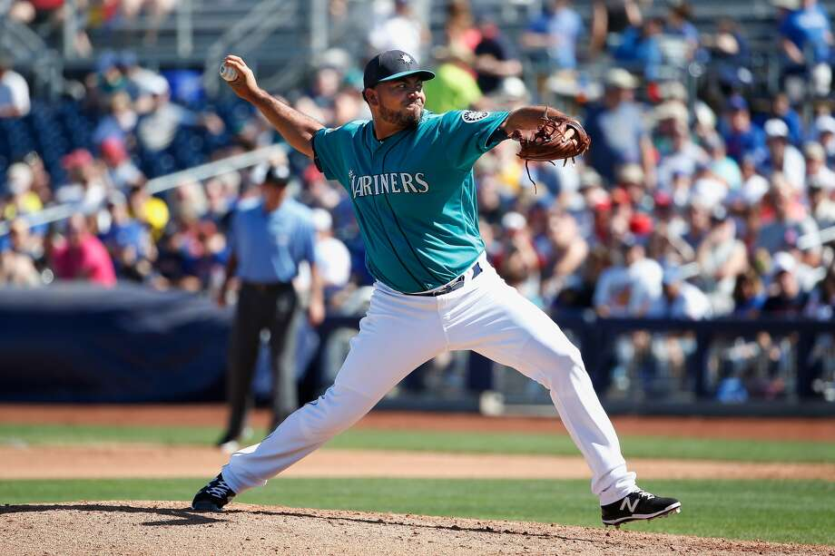 PEORIA, AZ - MARCH 10: Relief pitcher Joaquin Benoit #53 of the Seattle Mariners pitches against the Chicago Cubs during the spring training game at Peoria Stadium on March 10, 2016 in Peoria, Arizona. (Photo by Christian Petersen/Getty Images)