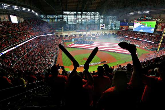 Keeshia (left) and Dane South, of Beaumont, throw their cheer during the player introductions and National Anthem at the beginning of the Houston Astros' home opener against the Kansas City Royals at Minute Maid Park, Monday, April 11, 2016, in Houston. The couple were hoping to start a new tradition attending the home opener for the first time together.
