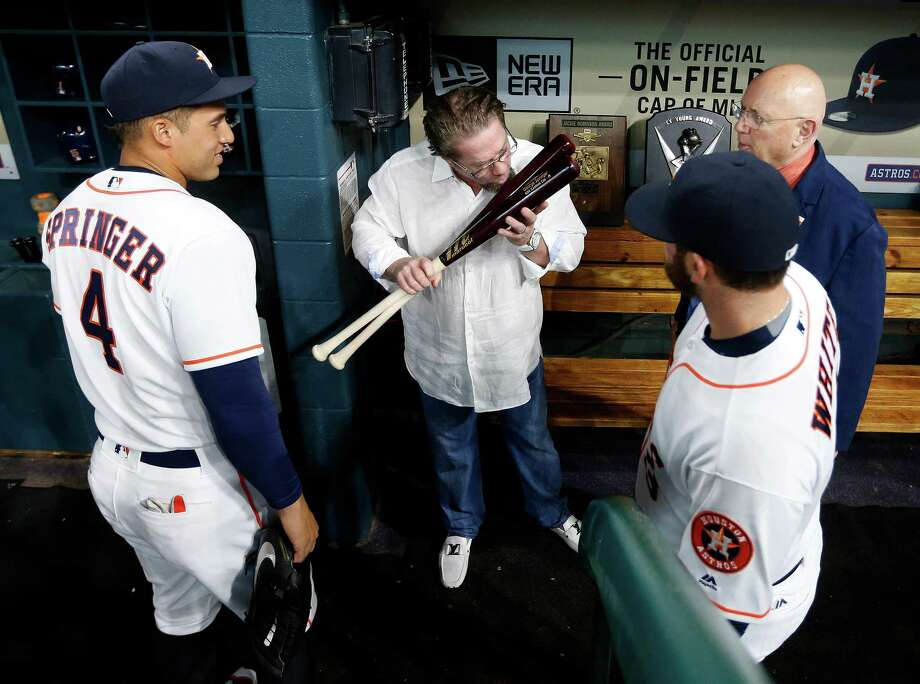Former Houston Astros first baseman Jeff Bagwell kisses Astros right fielder George Springer's bat in the dugout during pre-game ceremonies before the start of an MLB game at Minute Maid Park, Monday, April 11, 2016, in Houston. ( Karen Warren / Houston Chronicle ) Photo: Karen Warren, Staff / © 2016 Houston Chronicle
