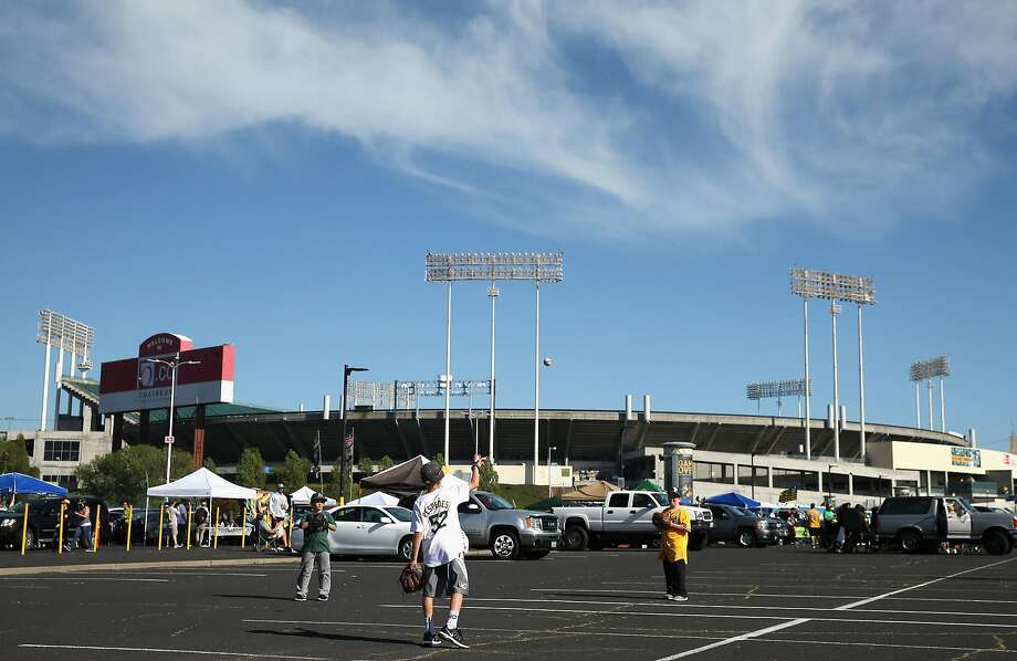 OAKLAND, CA - APRIL 04:  Fans play catch in the parking lot before the Oakland Athletics game against the Chicago White Sox on Opening Day at The Coliseum on April 4, 2016 in Oakland, California.  (Photo by Ezra Shaw/Getty Images) Photo: Ezra Shaw, Getty Images