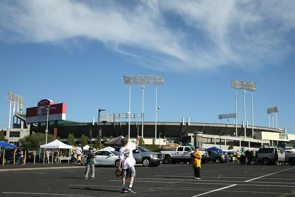 OAKLAND, CA - APRIL 04:  Fans play catch in the parking lot before the Oakland Athletics game against the Chicago White Sox on Opening Day at The Coliseum on April 4, 2016 in Oakland, California.  (Photo by Ezra Shaw/Getty Images)