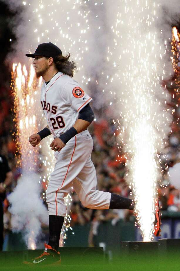 Houston Astros left fielder Colby Rasmus (28) runs onto the field during the Astros home opener against the Royals at Minute Maid Park Monday, April 11, 2016 in Houston. Photo: Michael Ciaglo, Houston Chronicle / © 2016  Houston Chronicle