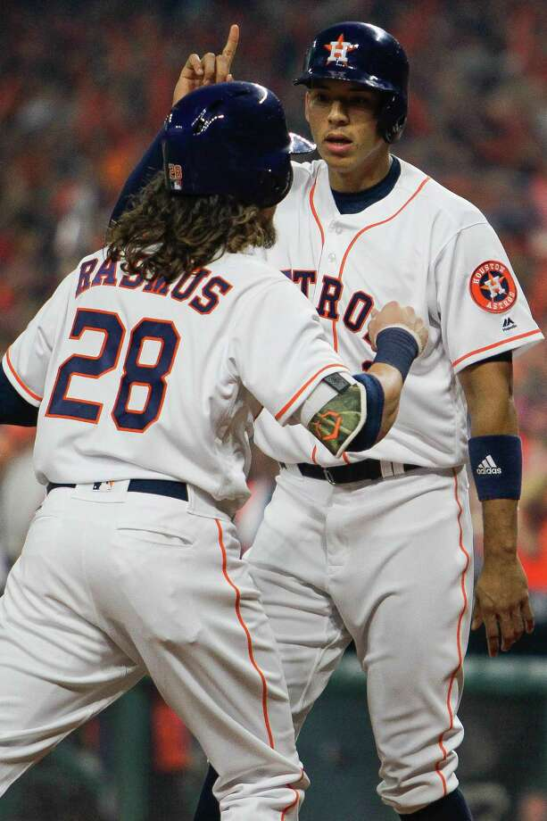 Houston Astros shortstop Carlos Correa (1) celebrates with Houston Astros left fielder Colby Rasmus (28) after Rasmus hit him in with a home run during the Astros home opener against the Royals at Minute Maid Park Monday, April 11, 2016 in Houston. Photo: Michael Ciaglo, Houston Chronicle / © 2016  Houston Chronicle