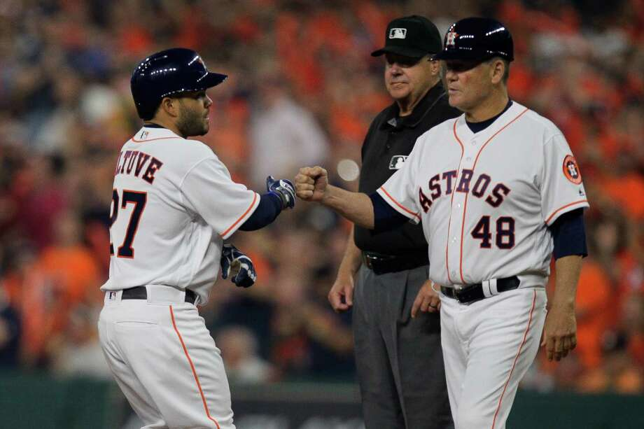Houston Astros second baseman Jose Altuve (27) celebrates a base hit with Houston Astros first base coach Rich Dauer (48) during the Astros home opener against the Royals at Minute Maid Park Monday, April 11, 2016 in Houston. Photo: Michael Ciaglo, Houston Chronicle / © 2016  Houston Chronicle