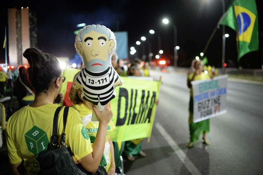 People demonstrate against Brazilian President Dilma Rousseff on Monday in the capital, holding a jumpsuit-clad figure of her mentor, former President Lula da Silva. A congressional committee on Monday recommended impeachment of Rousseff, moving the fight to the lower house. setting the stage for a crucial vote in the lower house to decide whether she should face trial. / AFP PHOTO / ANDRESSA ANHOLETEANDRESSA ANHOLETE/AFP/Getty Images Photo: ANDRESSA ANHOLETE, Stringer / AFP or licensors