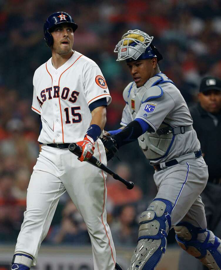 Houston Astros catcher Jason Castro (15) is tagged by Kansas City Royals catcher Salvador Perez (13) after he struck out during the second inning of an MLB game at Minute Maid Park, Monday, April 11, 2016, in Houston. Photo: Karen Warren, Houston Chronicle / © 2016 Houston Chronicle