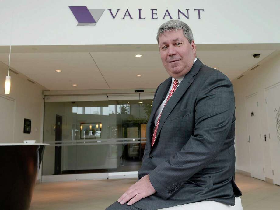 FILE - In this Tuesday, May 19, 2015, file photo, Valeant Pharmaceuticals CEO J. Michael Pearson poses at the company's annual general meeting in Montreal. Valeant Pharmaceuticals asked its CEO to cooperate with a Senate investigation into drug pricing after he failed to appear for a deposition. The Senate Special Committee on Aging said on April 6, 2016, that it planned to start legal proceedings against Pearson, who is leaving Valeant after months of turmoil for the drugmaker. Pearson is still under subpoena to appear before the committee for an April 27 hearing. (Ryan Remiorz/The Canadian Press via AP, File) MANDATORY CREDIT Photo: Ryan Remiorz, SUB / The Canadian Press
