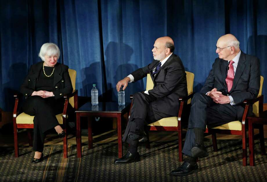Federal Reserve chair Janet Yellen, left, listens as former Federal Reserve chair Ben Bernanke, center, speaks and former Fed Chair Paul Volcker listens as the trio appeared together, Thursday, April 7, 2016, in New York. Former Fed Chair Alan Greenspan spoke via video conference. The forum was geared toward millennials and focused on how the Chairs' philosophies and personal beliefs impact decision-making with international implications. (AP Photo/Kathy Willens) Photo: Kathy Willens, STF / AP