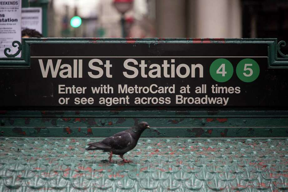 A pigeon stands underneath the Wall Street subway station sign near the New York Stock Exchange (NYSE) in New York, U.S., on Monday, April 11, 2016. U.S. stocks rose, with investors bracing for the start of what's forecast to be the biggest earnings slump since the financial crisis. Photographer: Michael Nagle/Bloomberg Photo: Michael Nagle, Stringer / © 2016 Bloomberg Finance LP
