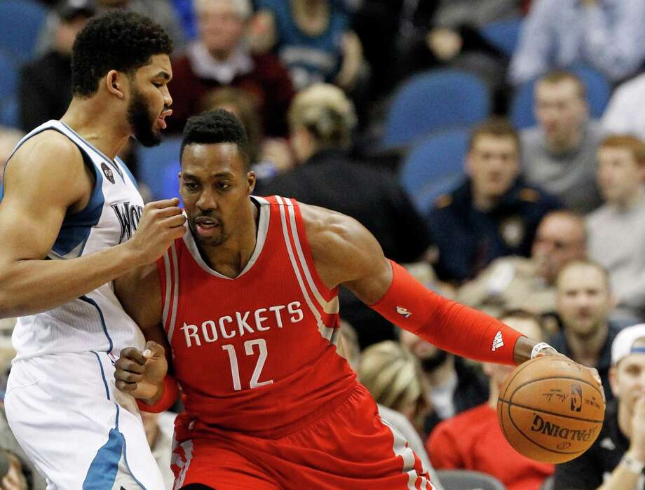 Houston Rockets center Dwight Howard, right, drives against Minnesota Timberwolves center Karl-Anthony Towns, left, during the first half of an NBA basketball game in Minneapolis, Monday, April 11, 2016.  (AP Photo/Ann Heisenfelt) Photo: Ann Heisenfelt, FRE / FR13069 AP