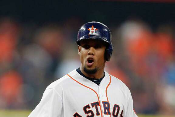Houston Astros center fielder Carlos Gomez (30) reacts after he flied out during the fifth inning of an MLB game at Minute Maid Park, Monday, April 11, 2016, in Houston.