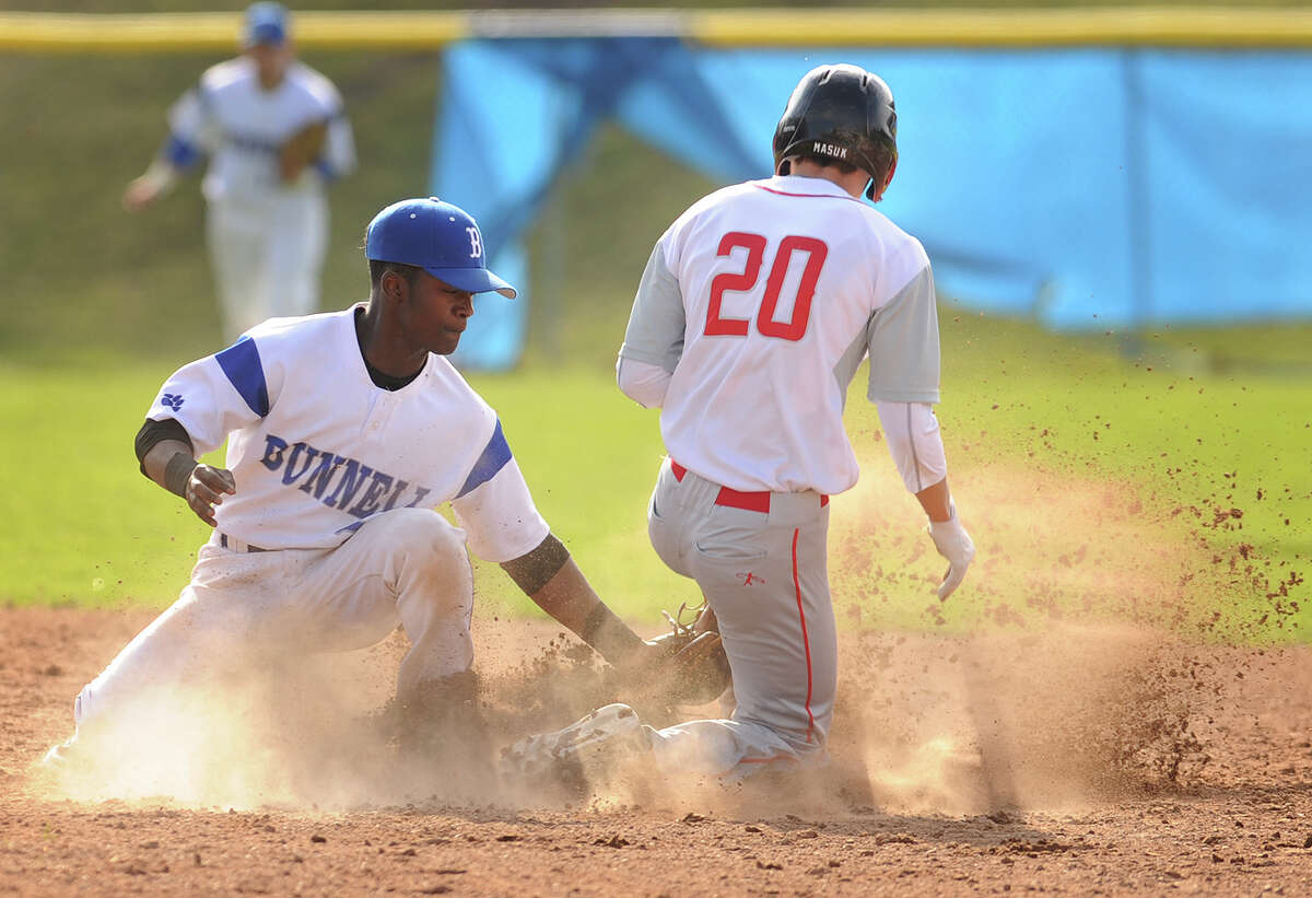 Bunnell second baseman Jonathan Och tags out Masuk's John Orzechowski during an attempted steal of second in the fifth inning Monday in Stratford. High school roundup on B3.