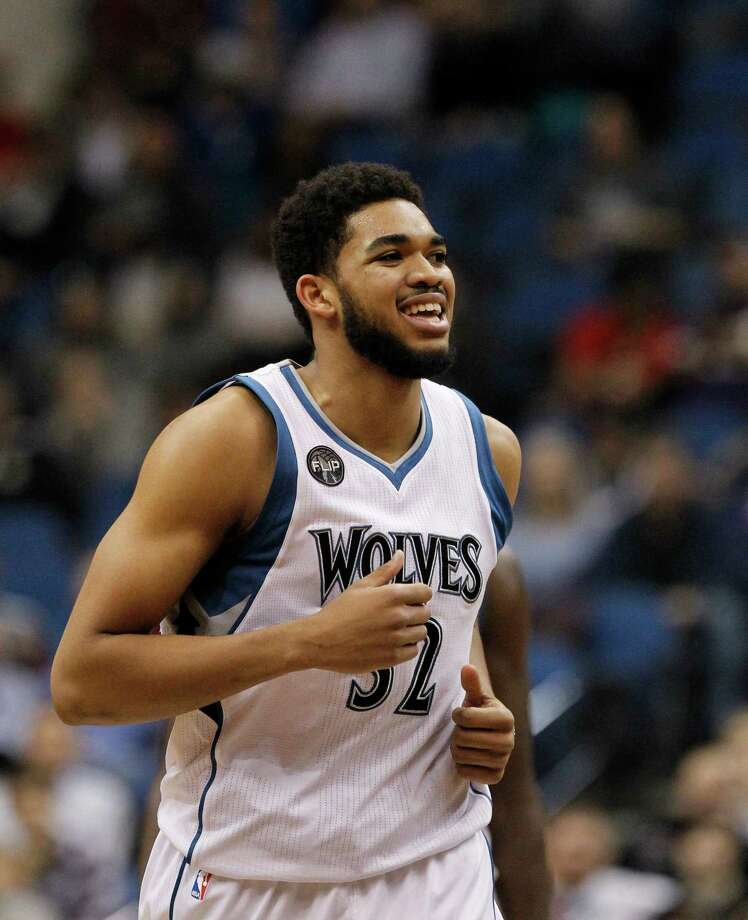 Minnesota Timberwolves center Karl-Anthony Towns (32) smiles during the second half of an NBA basketball game against the Houston Rockets in Minneapolis, Monday, April 11, 2016. The Rockets won 129-105. Photo: Ann Heisenfelt, AP / FR13069 AP