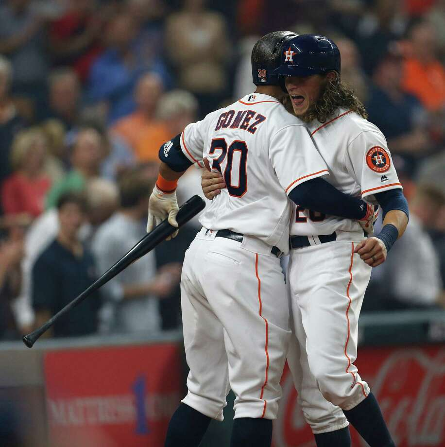 Astros left fielder Colby Rasmus, right, receives a warm welcome from Carlos Gomez after a two-run homer in the first inning set the tone on Monday night. Photo: Karen Warren, Staff / © 2016 Houston Chronicle
