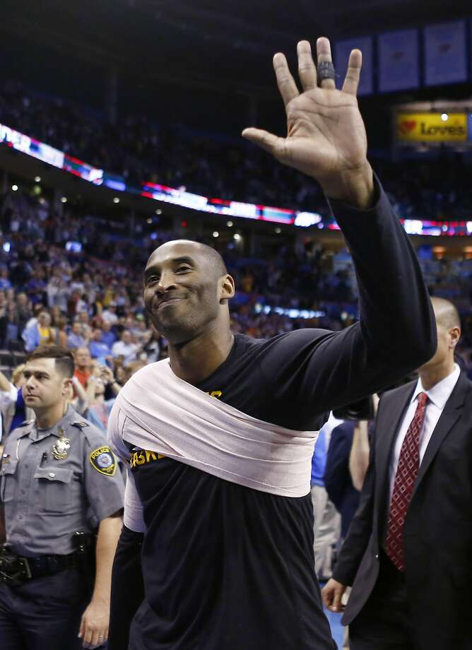 Kobe Bryant waves as he leaves the court after the Thunder routed the Lakers in Oklahoma City. Photo: Alonzo Adams, AP