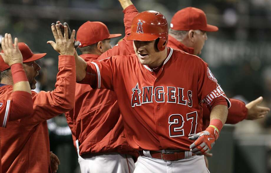 Mike Trout celebrates after hitting a two-run home run off Sonny Gray to cap the Angels' three-run sixth inning. Photo: Ben Margot, AP