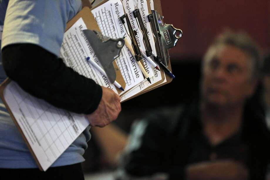 Shirley Golub holds clip boards with voter registration forms during a Bernie Sanders Barnstorm organizing meeting at Sports Page Bar in Oakland, Calif., on Monday, April 11, 2016. Photo: Carlos Avila Gonzalez, The Chronicle