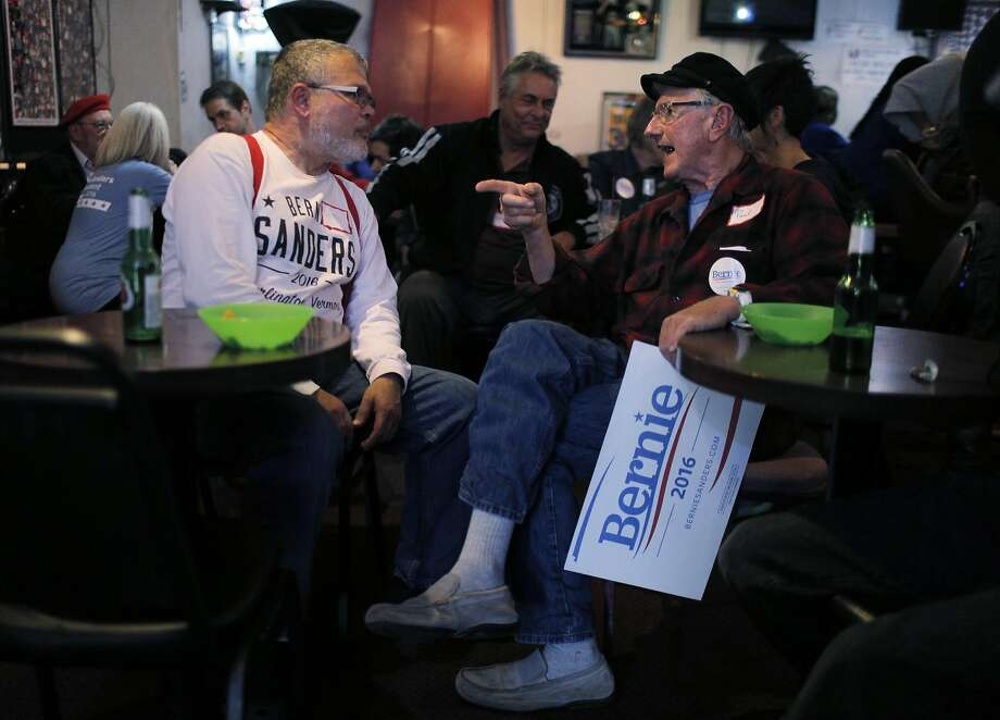 Peter Truskier, left, and Paul Mueller, right, chat during a Bernie Sanders organizing meeting at Sports Page Bar in Oakland, Calif., on Monday, April 11, 2016. Photo: Carlos Avila Gonzalez, The Chronicle