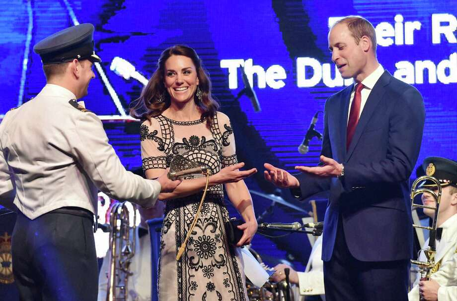 Britain's Prince William, and his wife Kate, the Duchess of Cambridge, prepare to cut a cake to celebrate Queen Elizabeth's 90th birthday, which is April 21 at the residence of British High Commissioner in New Delhi, India, Monday, April 11, 2016. William addressed a large gathering of prominent Indians at the reception to speak about his grandmother, Britain's longest-reigning monarch.(Vijay Verma/Pool Photo via AP) Photo: Vijay Verma, AP / PTI POOL