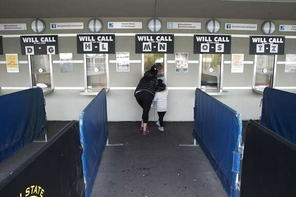 Kathy Perez talks to a ticket agant at the Oracle Arena ticket counter looking to see if tickets were available for the Warriors' final game in Oakland, Calif., on Monday, April 11, 2016.  Interest in the game is extremely high because the team could break the single season wins record.