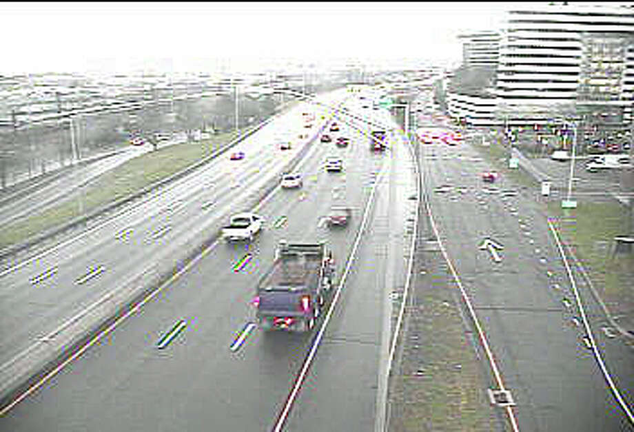 There was light traffic on I-95 in downtown Stamford at 6:52 a.m. on Tuesday, April 12, 2016. By then rain had moved into southwest Connecticut, making roads wet. The rain is expected to end by the afternoon commute. Photo: CT DOT