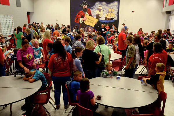 Elemetary students eat breakfast in the cafeteria on the first day of school in Deweyville since flooding devastated the town in March. The district's elementary, middle and high school were consolidated to the high school campus.  Photo taken Monday 4/11/16 Ryan Pelham/The Enterprise