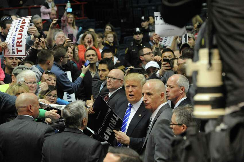 Republican presidential candidate Donald Trump interacts with the crowd at the end of a rally at the Times Union Center on Monday, April 11, 2016 in Albany, N.Y. (Lori Van Buren / Times Union)