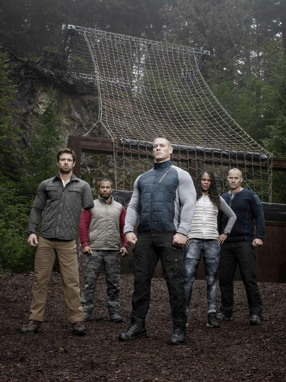 Host John Cena is flanked by military mentors Noah Galloway, Nick ?