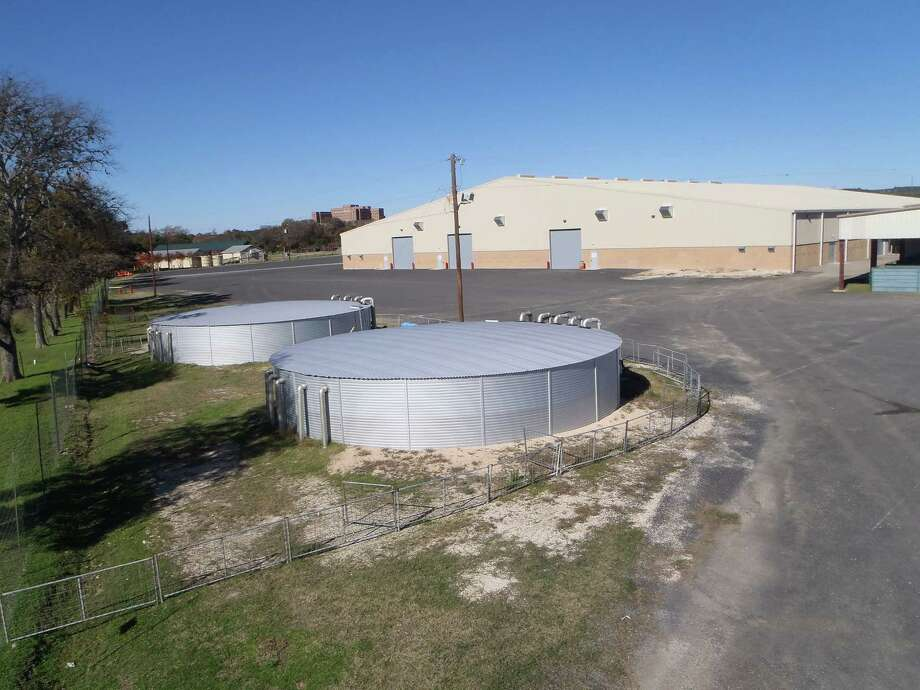 Tanks at the Hill Country Youth Event Center along with underground storage pipes can hold 152,000 gallons of rainwater collected from the facility's roof, a system whose scale might be the biggest in the U.S. Southwest. It won a Texas Water Development Board's Rain Catcher Award last week. Photo: Courtesy /