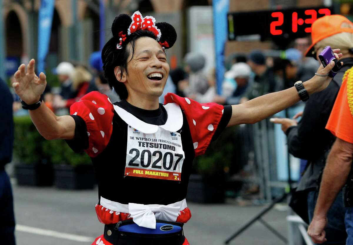 Tetsutomo Iizuka, from Japan, showed love for Disney movies in the running outfit. The annual San Francisco Marathon starts and ends on the Embarcadero. Marathon runners also ran across a foggy Golden Gate Bridge July 29, 2012.