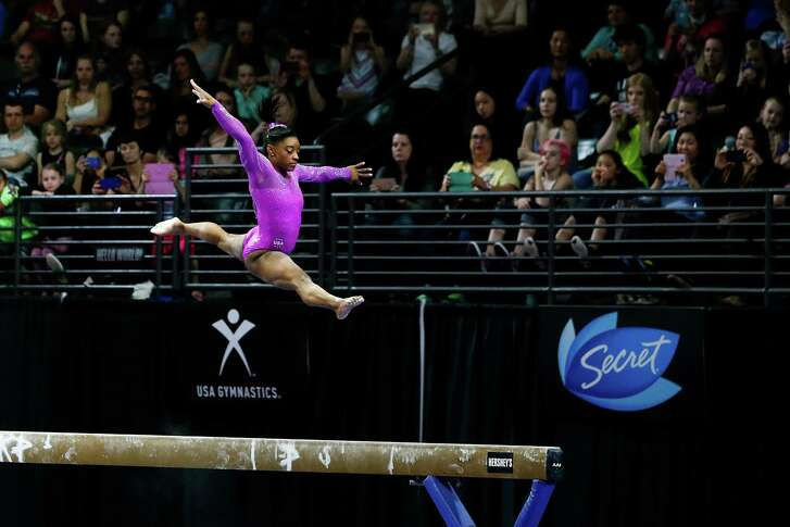 USA's Simone Biles leaps up during her routine on the balance beam during the second day of competition at the Pacific Rim Gymnastics Championships at Xfinity Arena in Everett, Wash., on Saturday, April 9, 2016. (Ian Terry/The Herald via AP)