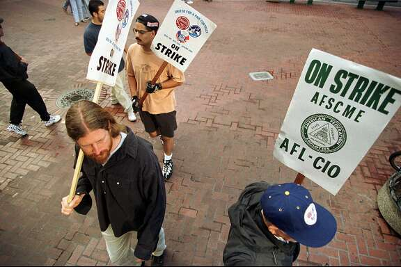 Striking BART train operators and station agents picket in San Francisco early Thursday morning, Sept. 11, 1997. The BART commuter service has been stalled for the fifth day and negotiations to settle the labor dispute are scheduled to continue later today. (AP Photo/Julie Stupsker)