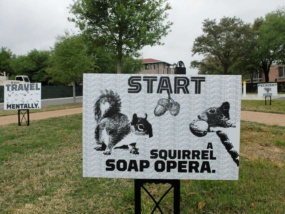 Funny signs are part of Zurkow's installation. Photo: Molly Glentzer, Houston Chronicle