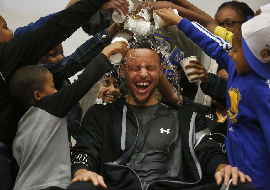 Students pour water onto Stephen Curry's head during an event at Martin Luther King Jr. Elementary School wherein Curry promoted drinking water and healthy eating in partnership with his sponsor Brita March 8, 2016 in Oakland, Calif. Photo: Leah Millis Leah Millis, The Chronicle