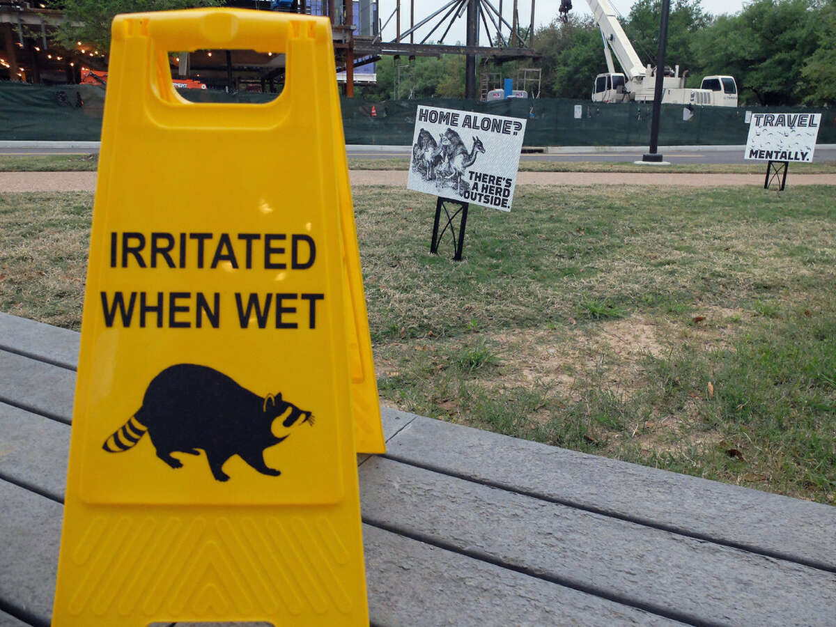 """Funny signs are part of Marina Zurkow's installatoin """"Dear Climate"""" at Rice University, which is on view through April 24."""