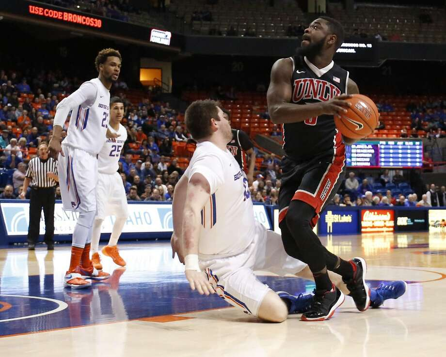UNLV's Jordan Cornish (3) gets collides with Boise State's Nick Duncan, and is called for charging during the first half of an NCAA college basketball game in Boise, Idaho, on Tuesday, Feb. 23, 2016. (AP Photo/Otto Kitsinger) Photo: Otto Kitsinger, AP