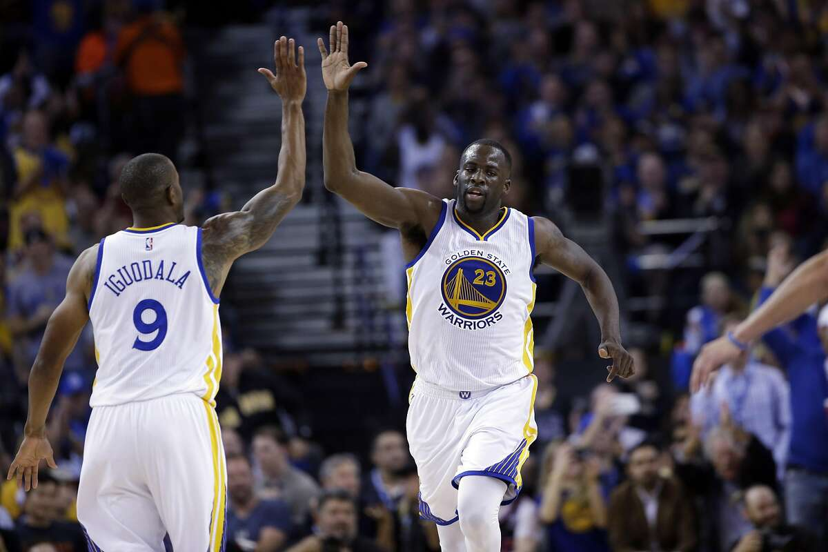 Golden State Warriors' Draymond Green (23) celebrates with Andre Iguodala (9) during the second half of an NBA basketball game against the San Antonio Spurs Thursday, April 7, 2016, in Oakland, Calif. Golden State won 112-101. (AP Photo/Marcio Jose Sanchez)