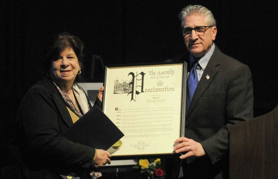 Assemblyman Jim Tedisco presents Mary Lyall with an Assembly proclamation during the 15th annual Missing Persons Day Remembrance on Saturday, April 9, 2016, at the New York State Museum in Albany, N.Y. (Michael P. Farrell/Times Union) Photo: Michael P. Farrell / 10036134A