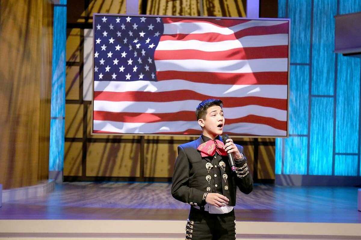 Sebastien De La Cruz belts anthem on Steve Harvey's national TV talk show.(Tegan Kinane/NBC)