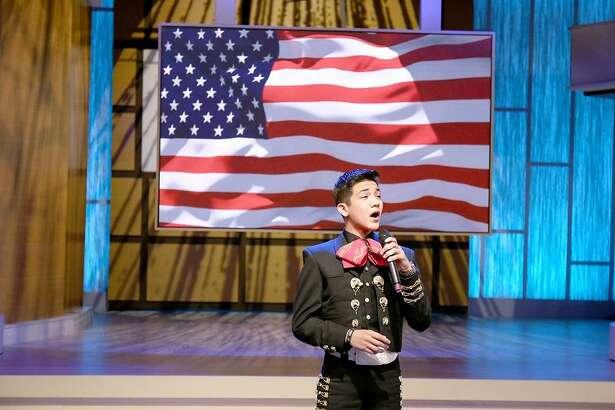 Sebastien De La Cruz sings anthem on Steve Harvey's national TV talk show.(Tegan Kinane/NBC)