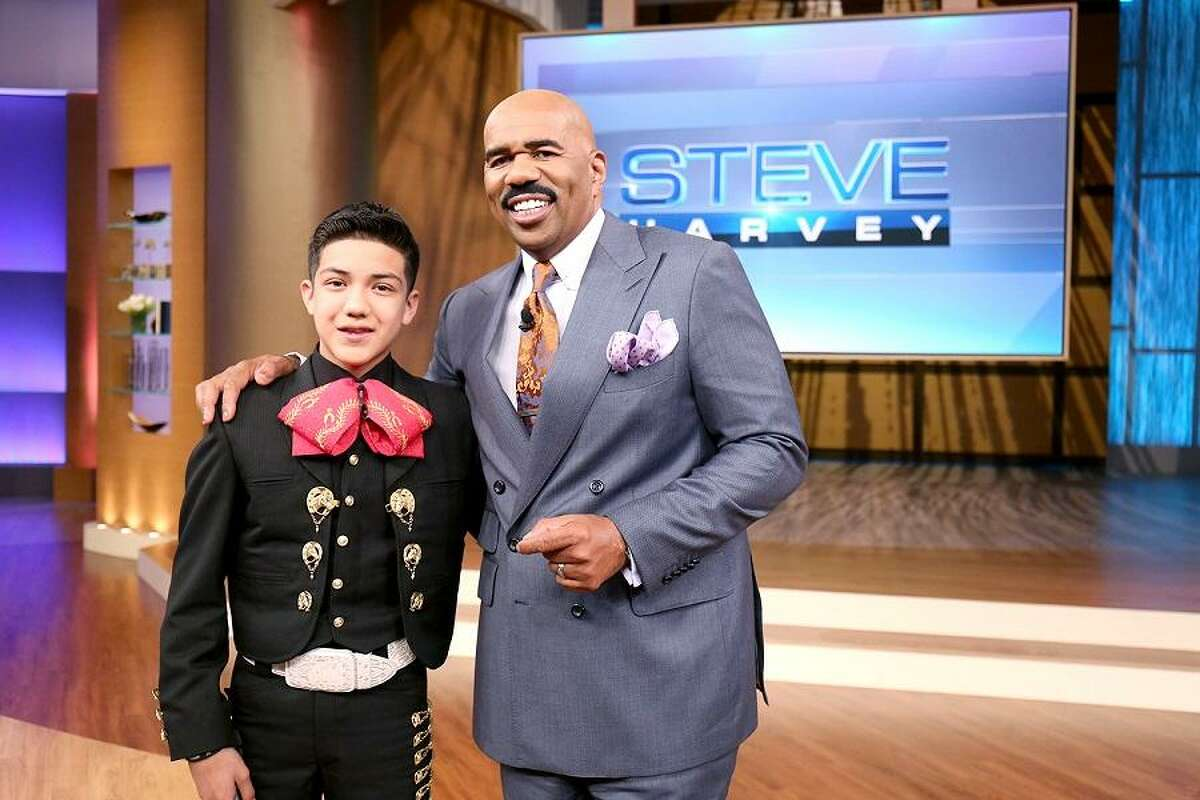Steve Harvey embraces the talent and grit of S.A.'s 'Little Mariachi.' (Tegan Kinane/NBC)