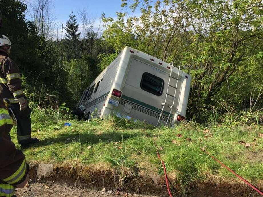 Seattle firefighters responded Tuesday morning to a motor home that went over an embankment in the Mount Baker neighborhood of South Seattle. No one was injured, but a dog was inside the vehicle.