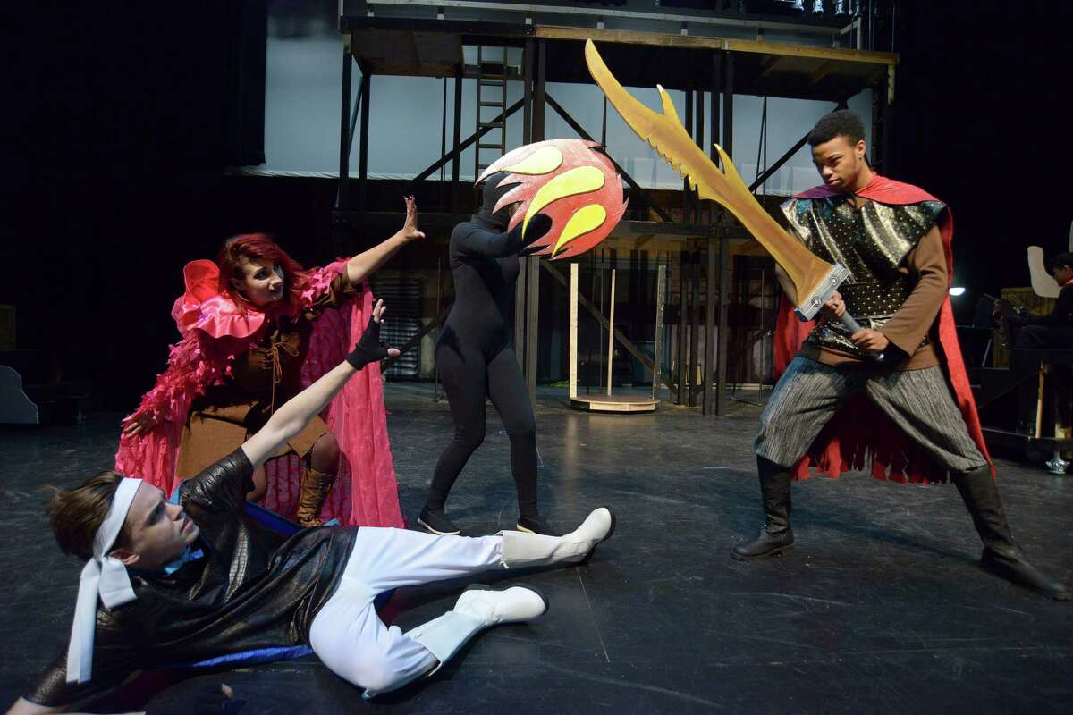 Connor Burton (bottom left) and Lauren Harmon shoot a magic fireball at Tristan Cowley during a rehearsal for